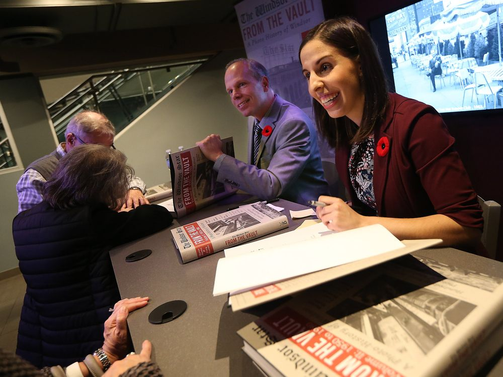 WINDSOR, ON. NOVEMBER 10, 2016. -- Authors Craig Pearson and Sharon Hanna (right) sign copies of the latest From the Vault book during a book launch in the Windsor Star News Cafe in Windsor on Thursday, November 10, 2016. (TYLER BROWNBRIDGE / WINDSOR STAR)